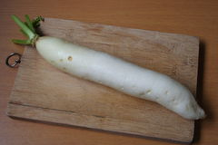 White Radish on a cutting board. Fresh white radish on a cutting board Stock Image