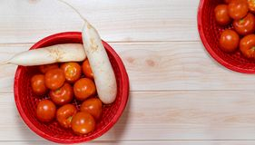 Tomatoes and radish on the table royalty free stock photo