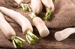 White radish on  wooden table. White radish on the wooden table Stock Photos