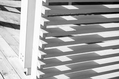White railings corner made of planks. Abstract wooden architecture fragment, white railings corner made of planks. Closeup photo with selective focus Royalty Free Stock Photos