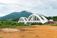 White railway bridge and mountain in background Royalty Free Stock Photo