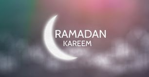 White ramadan graphic against blurry green purple background. Digital composite of White ramadan graphic against blurry green purple background Stock Photography