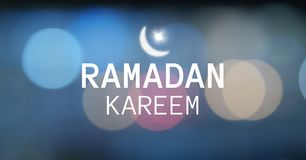 White ramadan graphic with flare against blue bokeh Stock Photography