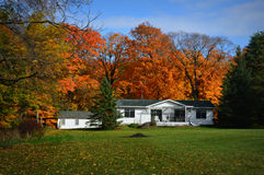 White Ranch Home, Fall Country Colors. A small white ranch style home amidst beautiful fall colors. Located in Lake Geneva, WI royalty free stock images