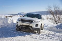White Range Rover Evoque with a black roof on a winter road on the background of Zhiguli mountains of Samara region. Russia. Clear Sunny day 9 February 2019 royalty free stock images