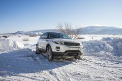 White Range Rover Evoque with a black roof on a winter road on the background of Zhiguli mountains of Samara region. Russia. Clear Sunny day 9 February 2019 royalty free stock image