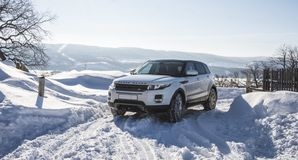 White Range Rover Evoque with a black roof on a winter road on the background of Zhiguli mountains of Samara region. Russia. Clear Sunny day 9 February 2019 stock photo