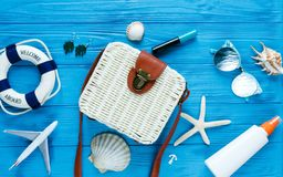 White rattan bag on blue background. Bamboo trendy bag, starfish, shells. Summer fashion flat lay, tourism, vacation, travel stock photos