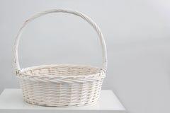 White rattan basket. On desk stock images