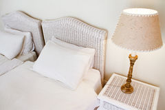 White rattan bed furniture in a luxury room Royalty Free Stock Photography