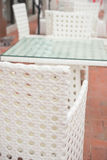 White rattan sofa and table sets in outdoor vertical Stock Photos
