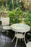 White rattan wicker chair and table on the terrace Royalty Free Stock Photography