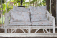 White rattan wicker swing bench with blue cushion and pillow in Royalty Free Stock Photography