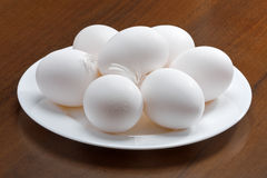White raw eggs on a plate Royalty Free Stock Photography