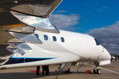 White reactive private jet. The front landing gear and wings Royalty Free Stock Images