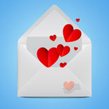 White realistic open envelope with red paper hearts. Stock Photo