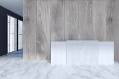 White reception in a modern office. Original white and concrete reception table standing in an office lobby with wooden walls and a white marble floor. 3d Stock Photos
