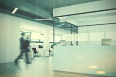 White reception in a white and glass office people. White and glass reception counter standing in an open office environment with white walls, a concrete floor Stock Photography