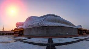 White reclining  buddha during sunset , Thailand Stock Image