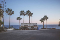 White Recreational Trailer Between Palm Trees Beside Sea during Daytime Photo Royalty Free Stock Photography