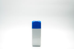 White rectangle bottle and blue cap isolated. On white background Stock Photography