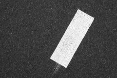 White rectangle on dark gray tarmac Royalty Free Stock Photos