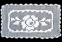 Rectangle lace tablecloth isolated on black background. White rectangle lace tablecloth isolated on black background. Cute out and texture for design. White Stock Image