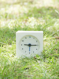 White simple clock on lawn yard, 9:15 nine fifteen Royalty Free Stock Image