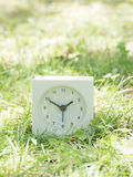 White simple clock on lawn yard, 1:50 one fifty Royalty Free Stock Photo