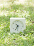 White simple clock on lawn yard, 10:35 ten thirty five Royalty Free Stock Photos
