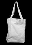 White recycle cotton bag. On black stock photography