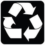 White recycle sign. On a black background Royalty Free Stock Photo