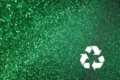 White recycle sign and green glitter lights background. defocused lights. Stock Image