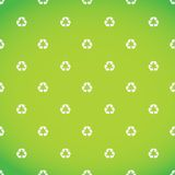White recycle symbol pattern green background Royalty Free Stock Photography