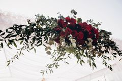 White and red arch and aisle at wedding reception in park, with. Red bouquet royalty free stock images