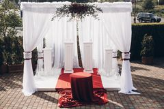 White and red arch and aisle at wedding reception in park. Wedding day royalty free stock images