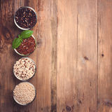 White, red, black and mixed raw quinoa grain Stock Image