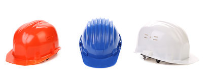 White red and blue hard hats Stock Photos