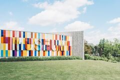 White Red and Blue Museum on Green Grass Royalty Free Stock Photography