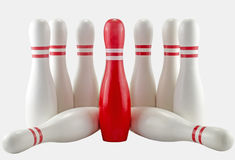 White and Red Bowling pins on White background. Studio shot of arrangement of white and red Bowling pins on isolated background Royalty Free Stock Photo