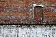 White and red brick wall. Red and white brick wall with blocked out window Stock Photos