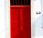 White  red brown  door in antique village santorini greece europ Stock Photos