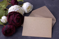 White and red buttercup flowers ranunculus envelope on plaster gray background. Copy space. Stock Images