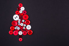 White and red buttons tree christmas background, isolated on dark grey background with copy space Stock Photo