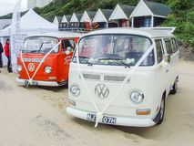 White and Red Campervan with White Wedding Ribbons on Front. Bournemouth, Dorset - 23 June 2015: White and Red Campervan with White Wedding Ribbons on Front royalty free stock image