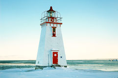 White and red canadian light house. New Brunswick white and red lighthouse in winter Stock Photos