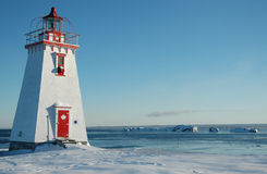 White and red canadian light house2. New Brunswick white and red lighthouse in winter, side view Royalty Free Stock Photography
