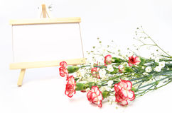 White and red carnations and message board. Royalty Free Stock Photo