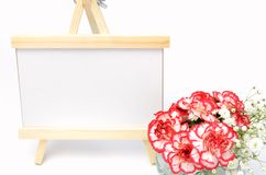 White and red carnations and message board. Royalty Free Stock Images