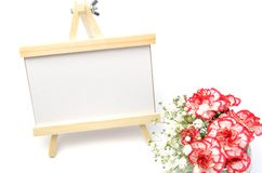 White and red carnations and message board. Royalty Free Stock Photography